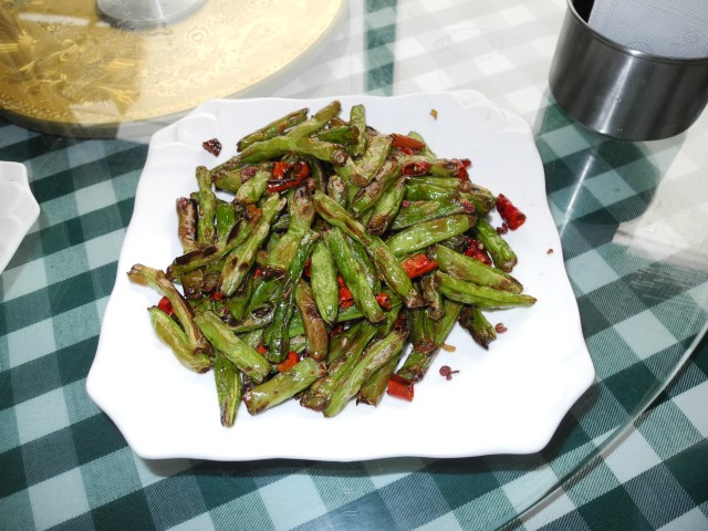 Best thing yet, crispy snap peas Szechuan style with peppers and peppercorns that will make your tongue tingle