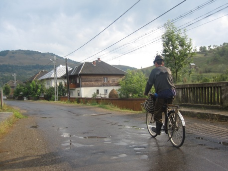 Coming back from the fields, you can see his scythe attached to his bike