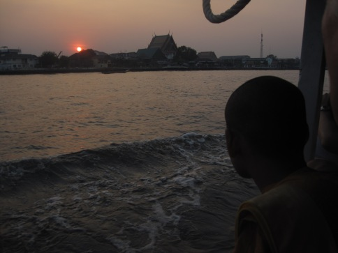 A monk gazing at the sunset