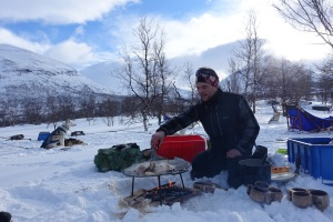 Our guide/owner of the dogs frying up smoked reindeer and onions served stew style in heavy cream